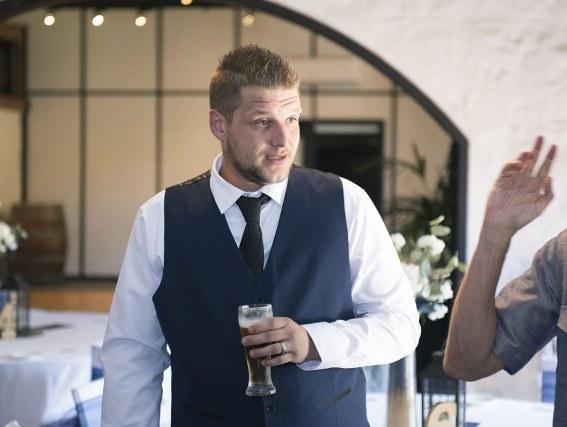 Groom enjoying a beer