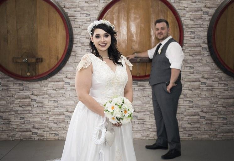 Bride in front of barrels