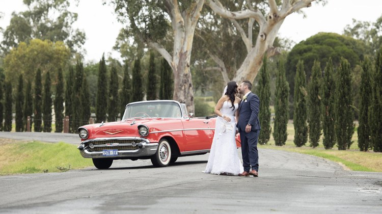 Couple in front of car