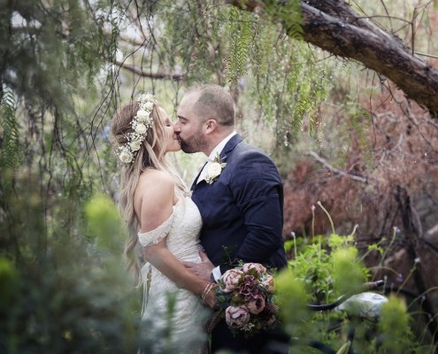 Kissing amongst the Pepper Tree
