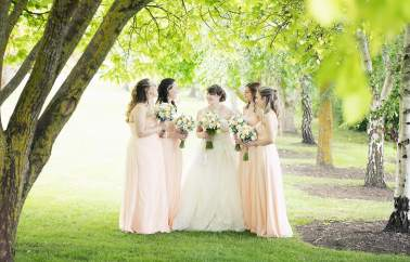 Bridal party under a tree