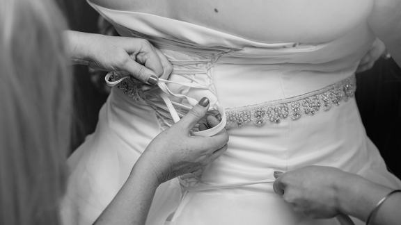 Lacing up the dress