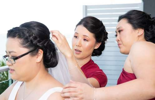 Bridesmaid putting in veil