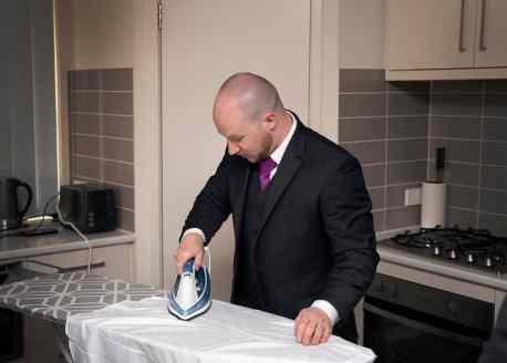 groom ironing
