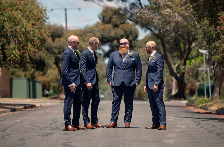 Groom and groomsmen on street