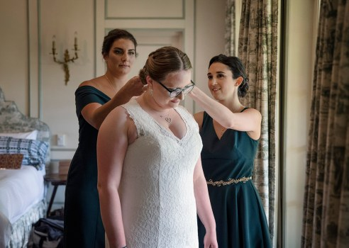 Bridal party helping bride get ready