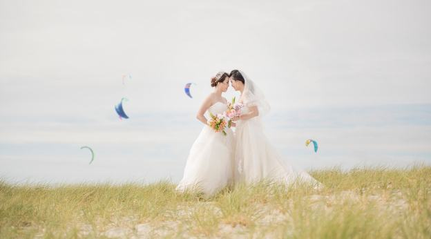 brides on the beach together