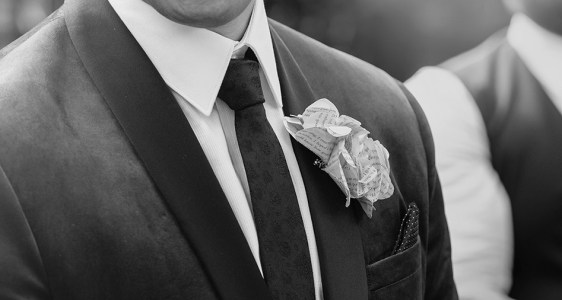 Close up of groom's Buttionaire
