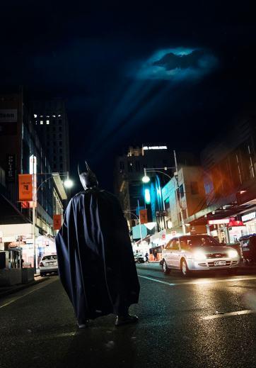 Batman looking at bat signal