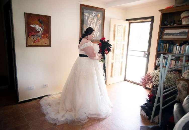 Bride standing in doorway