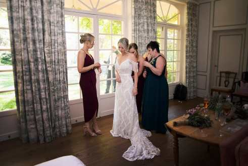 Girls helping out bride