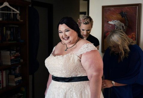 smiling bride while getting ready