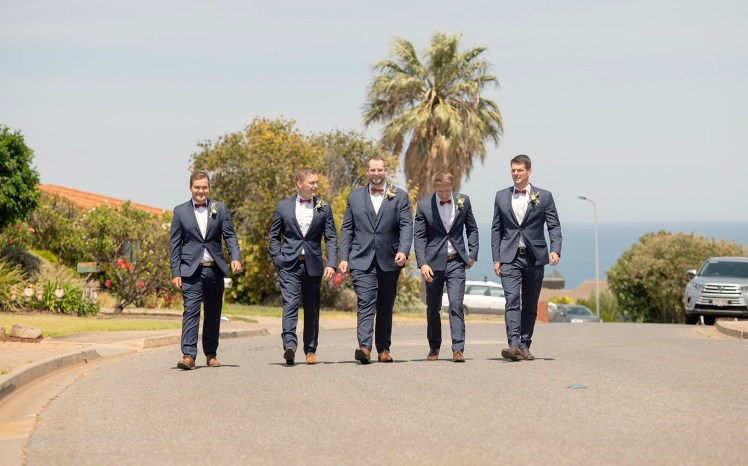 Groom and groomsmen on road