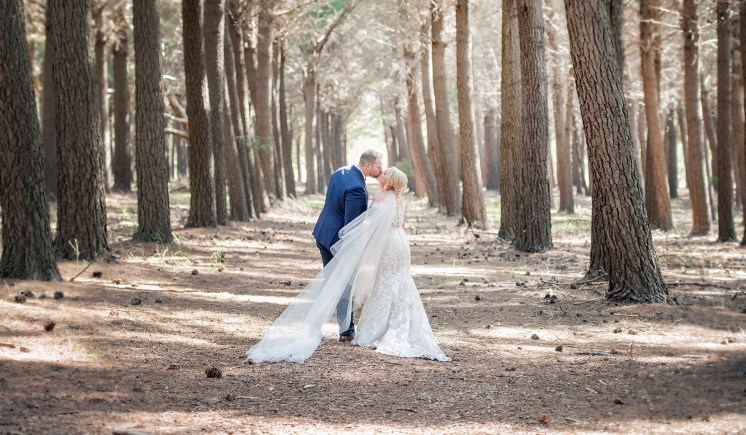 Bride and groom in amongst the trees