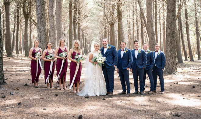 bridal party standing in Burbrook forest