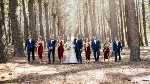 Bridal party walking otgether in Burbrook forest