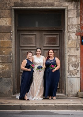 Bride and her bridesmaids together in a doorway