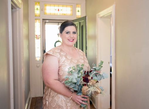 Bride looking pretty in hallway