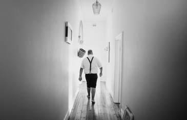 Groom walking the hallways