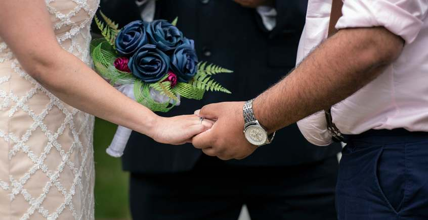 Holding hands during the ceremony