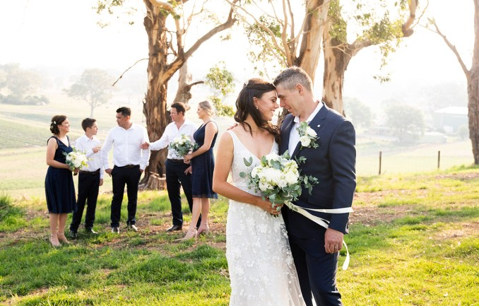 Bridal couple in front of bridal party