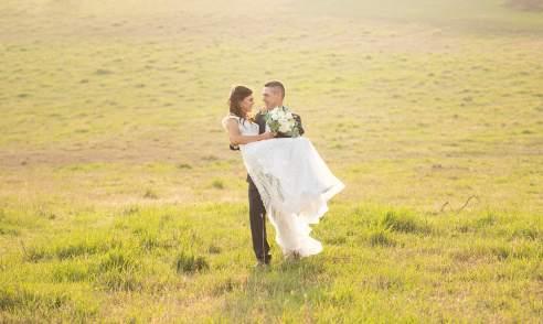 Groom carrying bride
