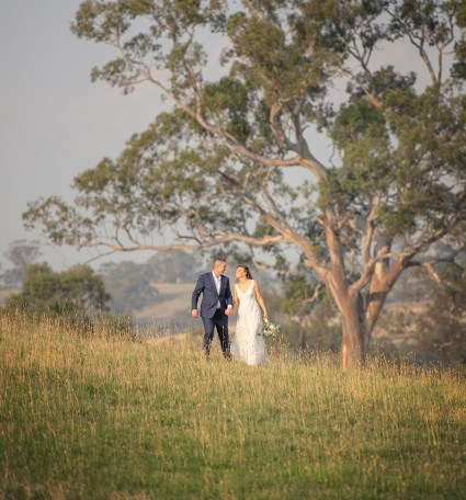 Walking together at their Lot 100 wedding