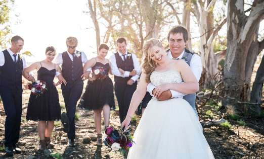 Fun together in front of bridal party