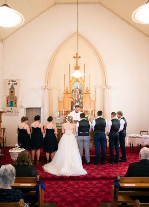 Standing together at the altar
