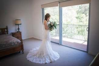 Bride looking pretty in wedding dress