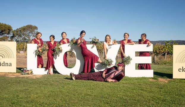 Bridal party on love sign