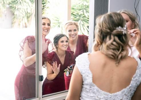 bridal party peeking through window