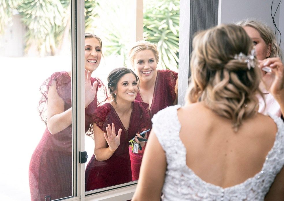 bridal party peeking through window