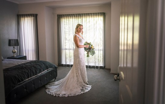 Bride looking pretty in wedding dress