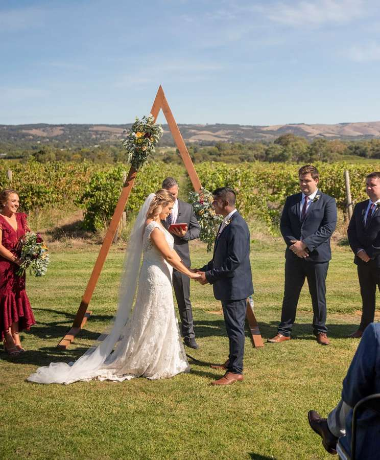 Ekhidna wines wedding ceremony with triangle arbour