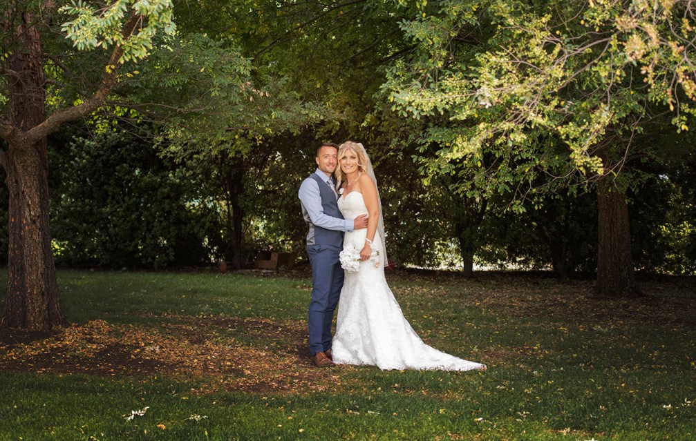 Bride and groom holding one another