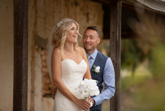 bride and groom in ruins at Paxton Winery