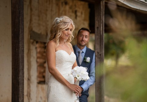 Groom looking at bride