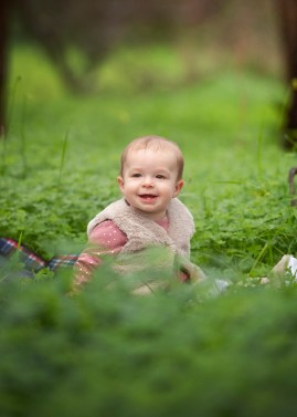 Happy baby in grass