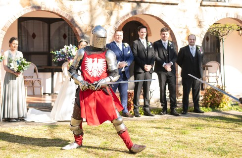 Knight in front of bridal party