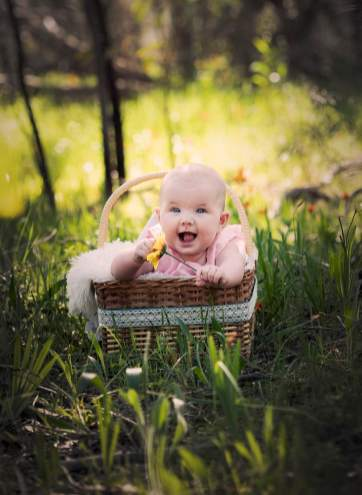 Smiling baby in a basket 3