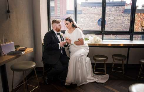 Bridal couple overlooking peel st