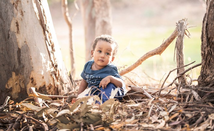 Amani sitting in the gum trees