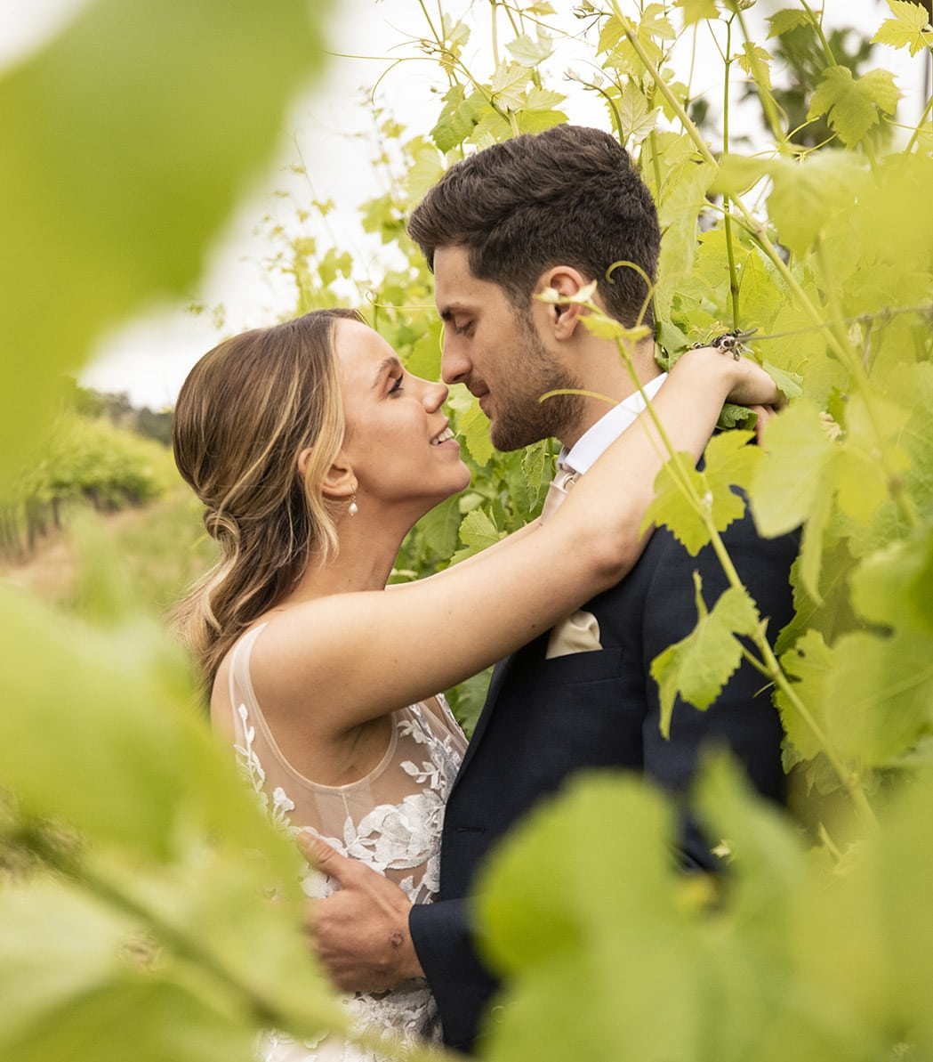 Bride and groom sharing a moment in the vineyards