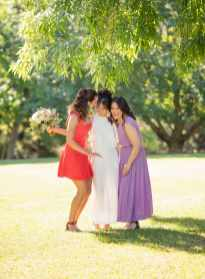 bridal party under green trees