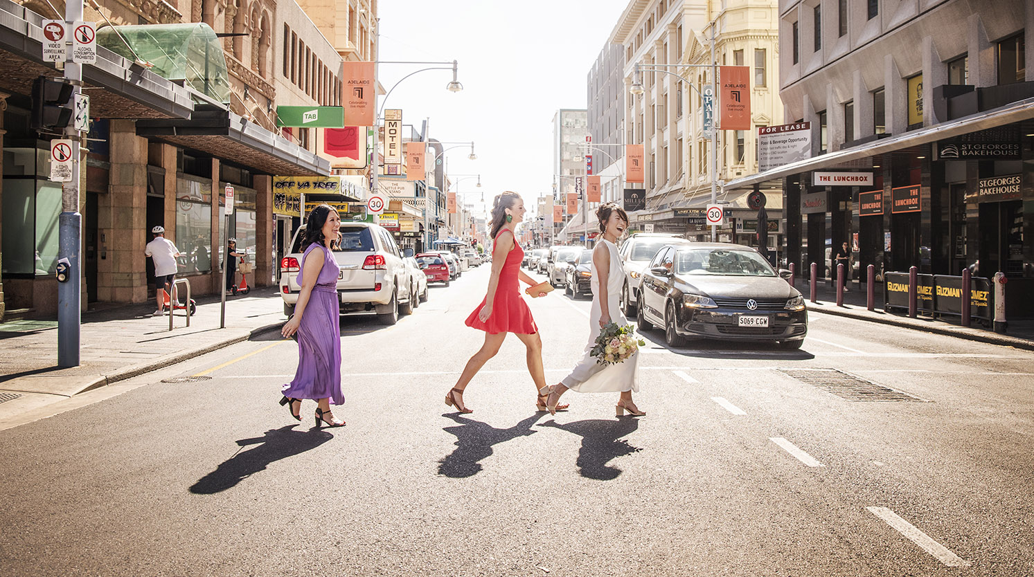 bridal party walking accross Hindley st