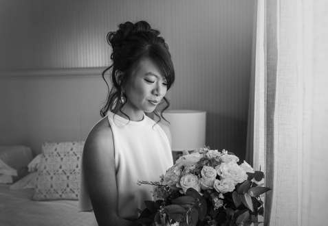bride holding bouquet black and white