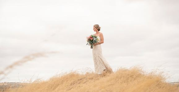 Bride on a grassy hill