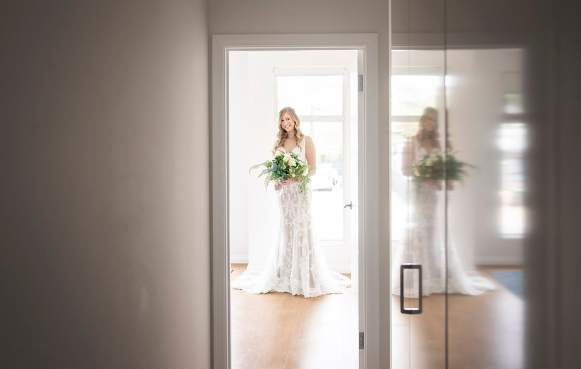 Bride standing at end of hallway