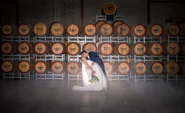 Serafino wines wedding photo in barrel room 2